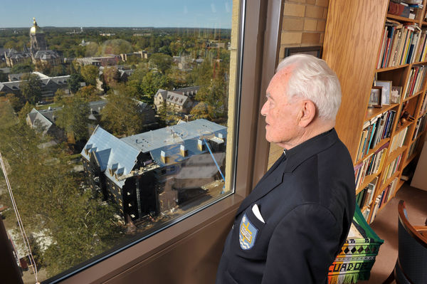Hesburgh surveying campus from his Library-based office