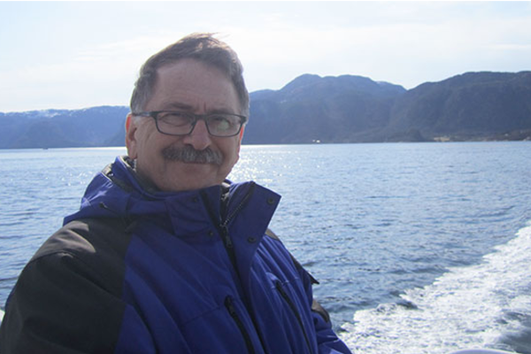 Tim Machan on a boat off the coast of Norway